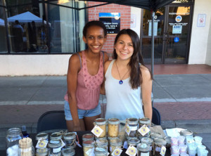 Glencoe High students Ruth Teklu, left, and Becca McInally launched their own company to sell handmade skincare products at Hillsboro's Tuesday Market as part of the Hillsboro School District's efforts to connect all students to a career of their choice and promote teen entrepreneurship. (Courtesy of Hillsboro School District)